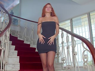 Gorgeous ginger babe Agatha is posing on an obstacle stairway
