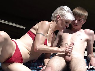 Kinky granny relating to thongs sucks a big hard penis for one young guy